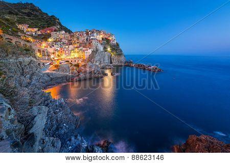 Manarola town on the coast of Ligurian Sea at dusk, Italy