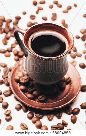 Vintage cup of coffee with beans
