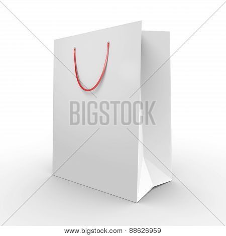 White paper shopping bag or grocery bag with carrying handles
