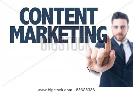 Business man pointing the text: Content Marketing