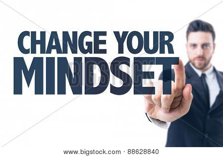 Business man pointing the text: Change Your Mindset
