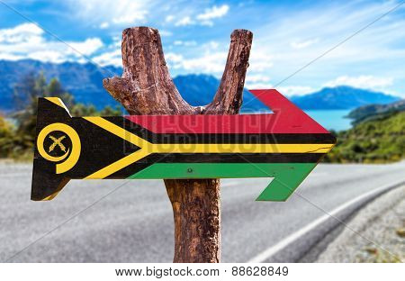 Vanuatu Flag wooden sign with road background
