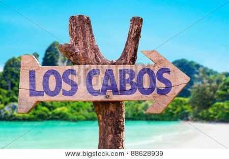 Los Cabos wooden sign with beach background