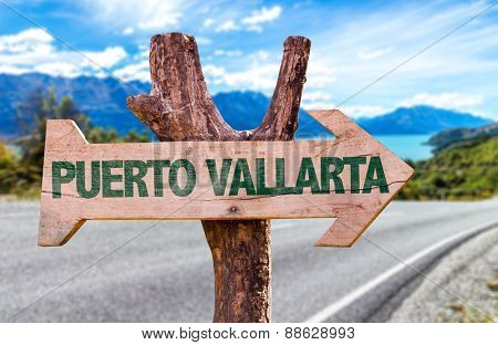Puerto Vallarta wooden sign with road background