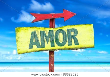 Love (in Portuguese) sign with beach background