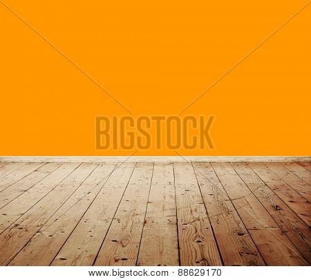 Empty room with orange wall and wooden floor