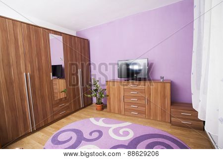 Bedroom with pastel purple wall