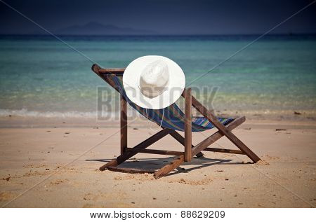 Exotic beach holiday - beach chair and hat