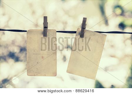 Old blank photos hanging on the clothesline - retro styled photo
