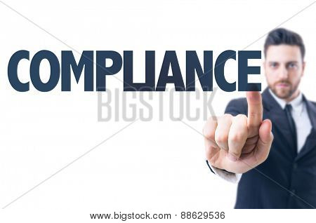 Business man pointing the text: Compliance