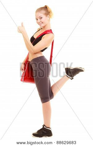 Sport. Fitness Sporty Girl With Gym Bag Showing Thumb Up
