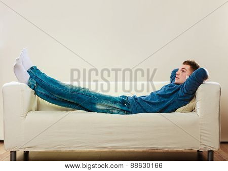 Young Pensive Man Relaxing On Couch