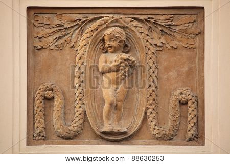 Funny little girl. Art Nouveau building decoration at Bubenecska Street in Prague, Czech Republic.