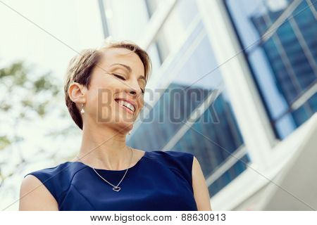 Businesswoman in city holding his notebook