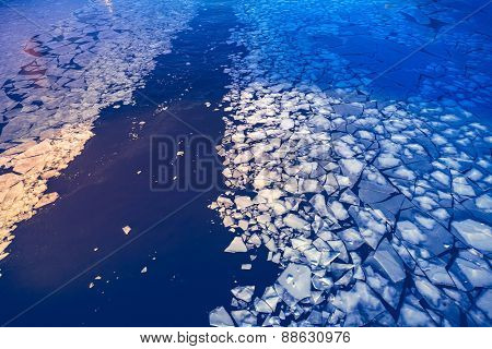 Crashed ice on the river surface. Abstract background