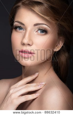 Beautiful girl with a gentle bridal makeup and long eyelashes. Beauty face.