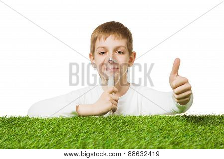 Boy breathing through inhalator mask thumb up