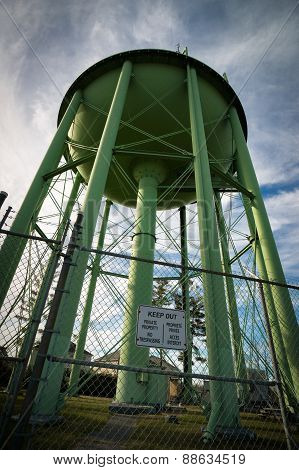 Looking Up At Giant Green Water Tower