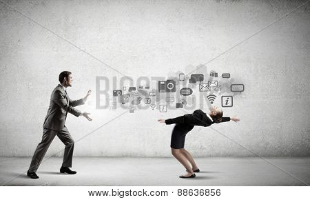 Young businesswoman trying to evade from thrown icons