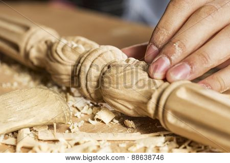Close up of carpenter's hands working with cutter in his studio