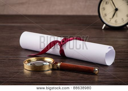 Wrapped Paper Sheets And Magnifying Glass
