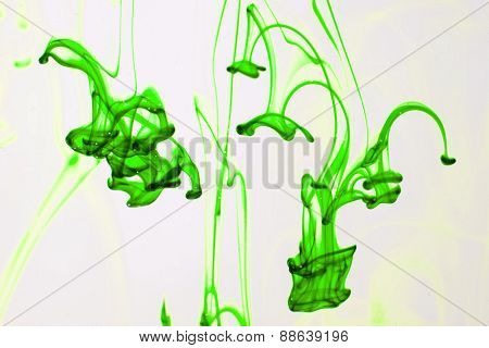Green Liquid Ink  In Water Making Abstract Forms