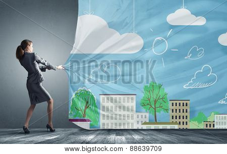 Young pretty businesswoman pulling clothing banner with illustration