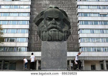 CHEMNITZ, GERMANY - MAY 8, 2012: Skateboarders training in front of the Karl Marx Monument by Soviet sculptor Lev Kerbel in Chemnitz, Saxony, Germany.