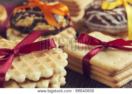 Stack of delisious cookies and biscuits folded with ribbon