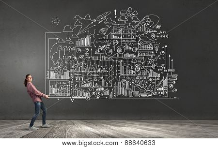 Young woman carrying out ideas of business plan