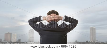 Businessman standing and looking at city