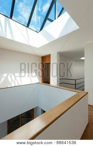 Architecture, Interiors of empty apartment, passage with skylight