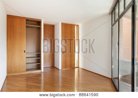 Architecture, Interiors of empty apartment, room with wardrobe