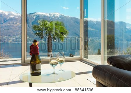 aperitif on the veranda, interior of a mountain home, lake view