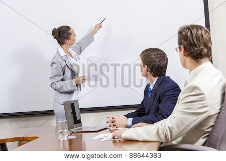 Young businesswoman giving a presentation to her colleagues