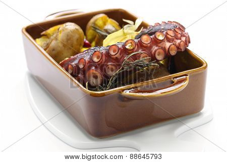 grilled octopus with potatoes, polvo a lagareiro com batata a murro, Portuguese cuisine isolated on white background