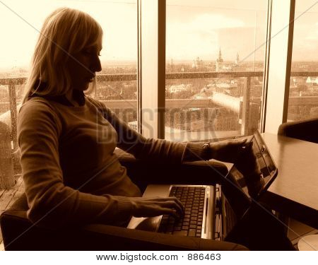 Beautiful Woman Working On 24Th Floor