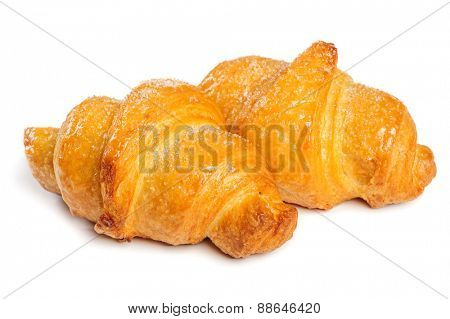 Two fresh just baked croissants on white background, isolated