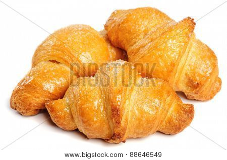 Three fresh just baked croissants on white background, isolated