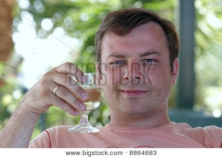 Man With Glass Of White Wine