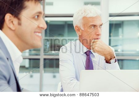 Businesspeople in office having discussion