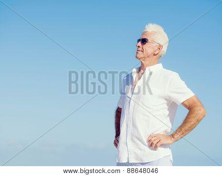 Handsome man against blue sky