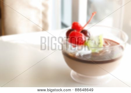 Blurry Defocused Image Of Chocolate Pudding Mousse With Mix Fruit On Top For Background
