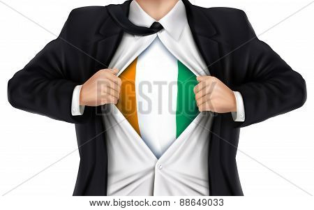 Businessman Showing Ivory Coast Flag Underneath His Shirt