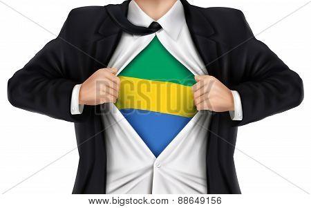 Businessman Showing Gabon Flag Underneath His Shirt