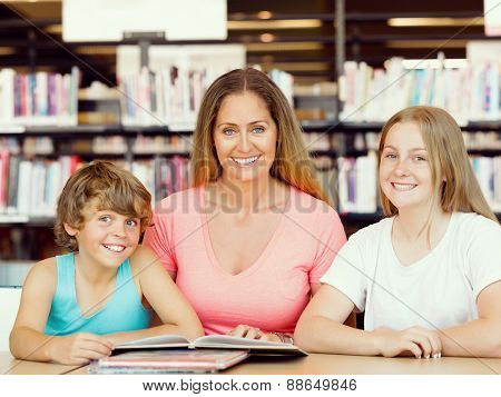 Mother with kids in library with books