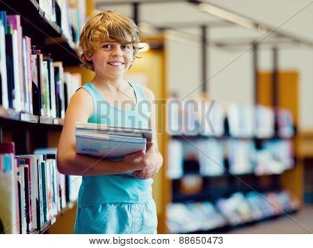 Boy in library choosing books