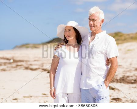 Happy couple together on the beach