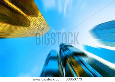 low angle view of modern skyscraper in blur motion