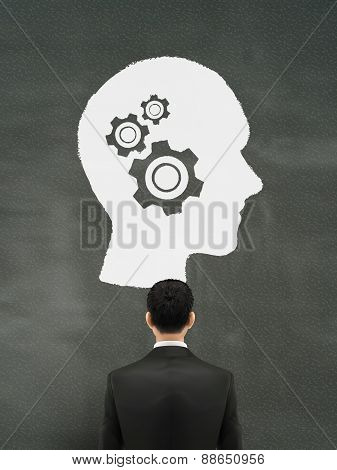 Businessman Looking At Thinking Brain Graph
